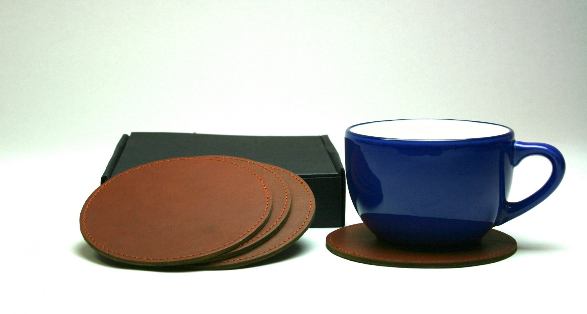 BROWN LEATHER ROUND COASTERS